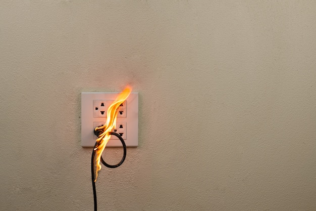 Electric wire plug on fire