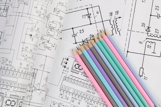 Electrical engineering drawings and pencils.