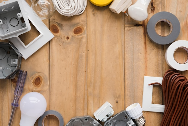 Electrical equipment arranged in circular frame on wooden table
