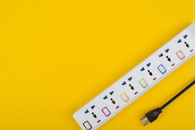 Electrical power strip or extension block with switch top view on colorful background