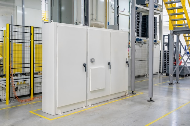 Electrical room in a manufacturing factory industry. electric wires, cabinets, servers.