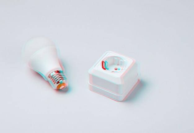회색 배경에 전기 소켓 및 led 전구. 글리치 효과