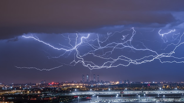 Electrical storm discharging lightning on the city