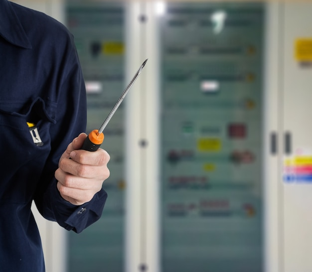 Electrician holding a screwdriver