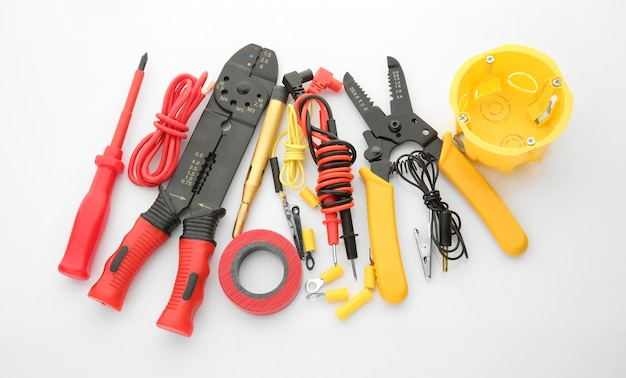 Electrician's supplies on white surface