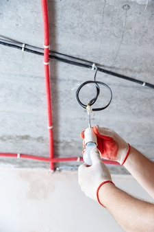 Electrician setting a light bulb for temporary lighting