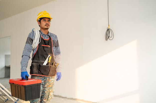 Electrician working and checking production process at the construction site,engineer,construction concept.