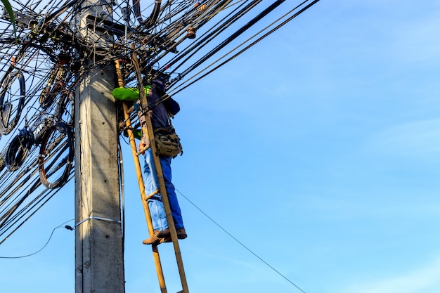 Electricians replacing the mains cable high voltage