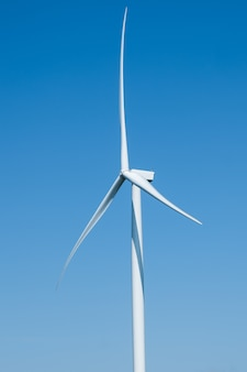Electricity generating wind turbines closeup with blue sky