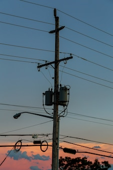 Electricity poles with sunset,silhouette