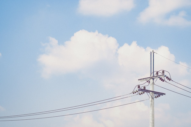 Electricity post against blue sky with copy space environment concept idea background