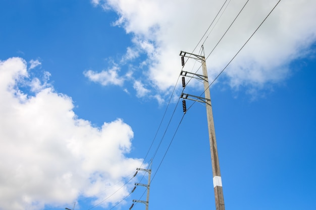 Electricity post and the cable with the blue sky