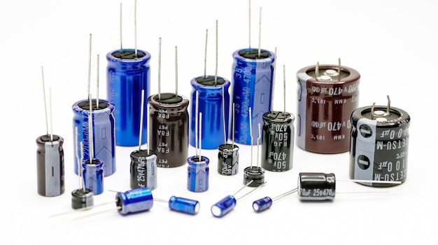 Electrolytic capacitors many colors and sizes white background electronic component concepts
