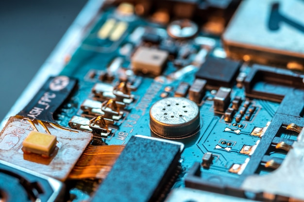 Electronic board of phone with semiconductor elements close up