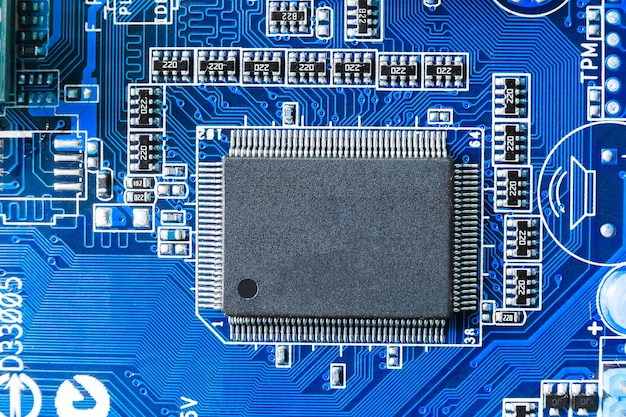 Electronic chip and smd components on blue circuit board