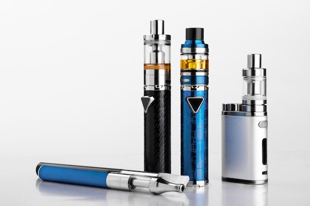 Electronic cigarettes or vaping devices on white background