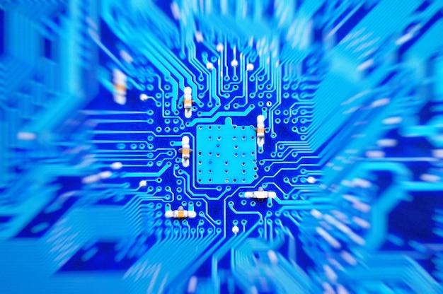 電子回路基板のクローズアップ。抽象的な背景パターン。