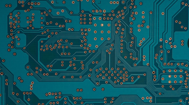Electronic circuit board close up. blue pcb circuit background