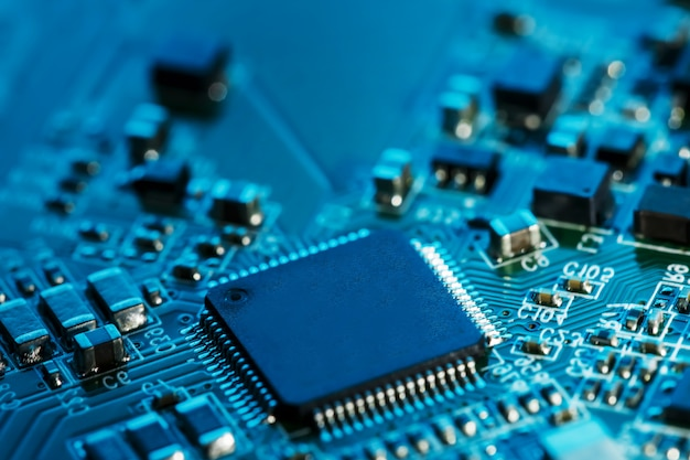 Electronic circuit board close up. processor, chips and capacitors.