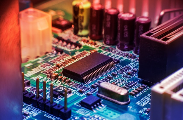 Electronic circuit board close up with colorful styles.