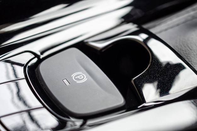 Electronic handbrake button in luxury modern car