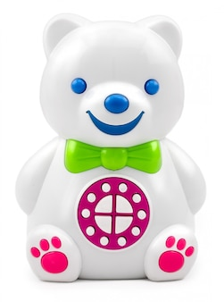 Electronic interactive children's toy speaker bear with the control panel buttons on isolated.