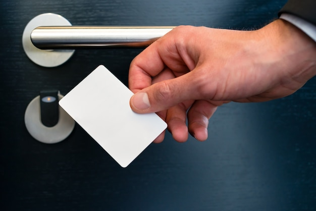 Electronic keycard for room door in modern hotel