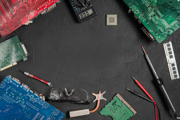 Electronic tools with computer circuit boards on black surface