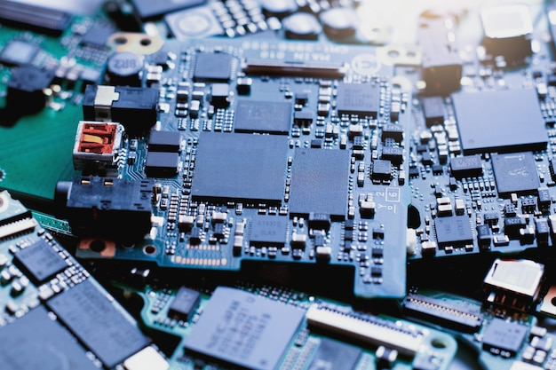 Electronic waste, semiconductor in printed circuit board, technology background.