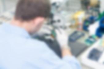Electronics production plant theme blur background