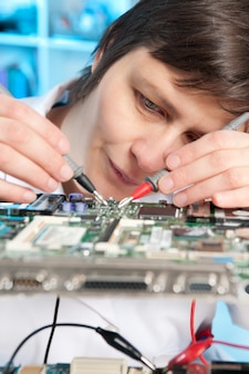 Electronics repair tech at work