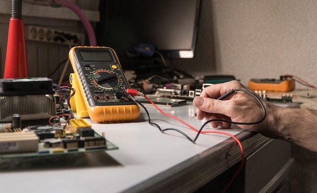 Electronics technician is testing a computer chip. pc repair