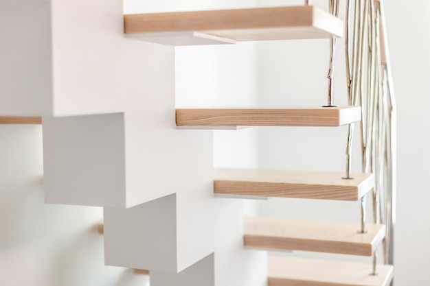 Elegance contemporary designed stairs in a white modern room of luxury apartment.