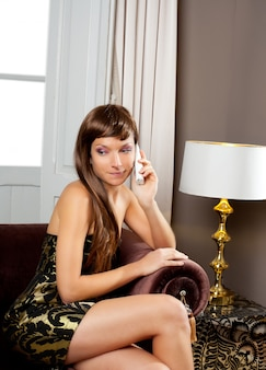 Elegance fashion woman talking telephone in sofa