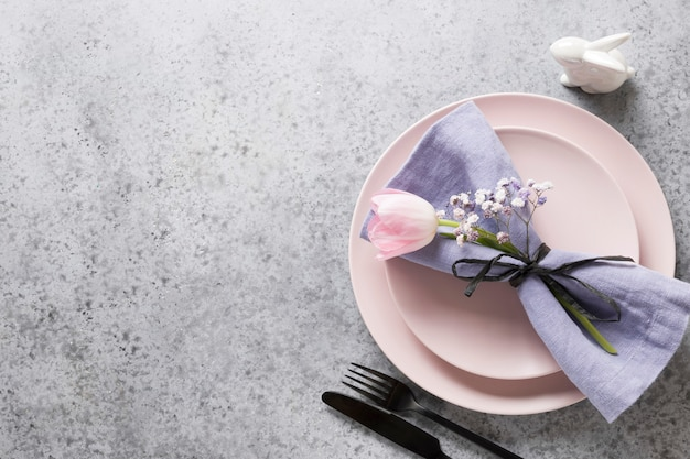 Elegance spring table setting with pink tulip on grey. wedding table setting. top view.