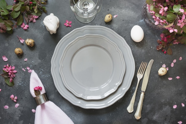 Elegance table setting spring flowers on dark. easter romantic dinner. top view.