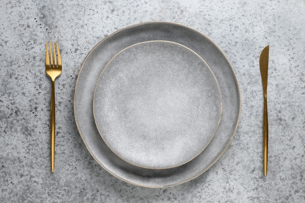 Elegance table setting with empty gray plate as mockup