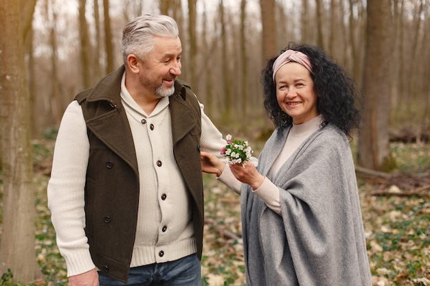Elegant adult couple in a spring forest
