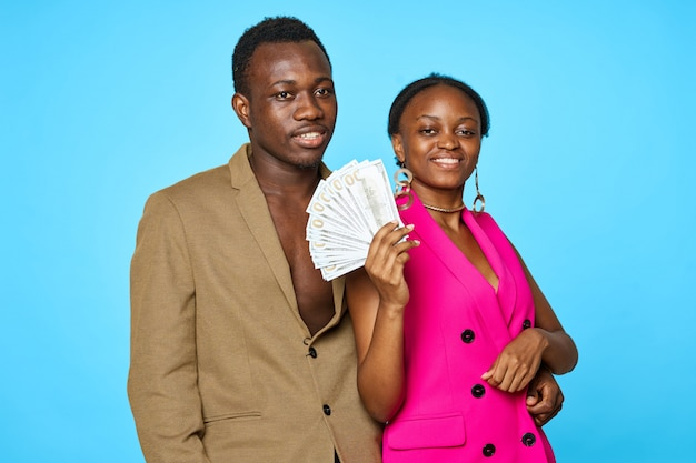 Elegant african american couple with money, wealth concept