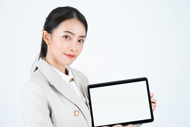 Elegant asian businesswoman show digital tablet with white blank screen