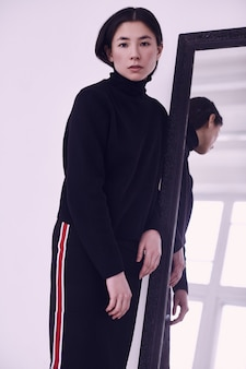 Elegant asian woman in fashionable black skirt
