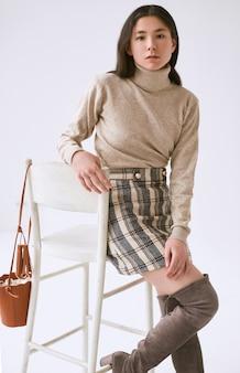 Elegant asian woman in fashionable woolen skirt
