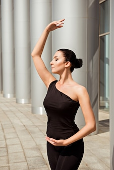 Elegant ballerina dancing in the street