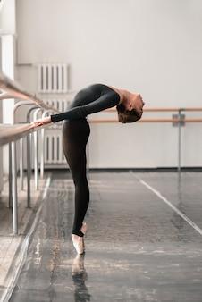 Elegant ballet dancer rehearsal in class