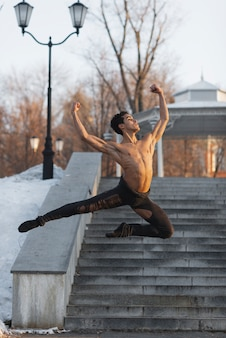 Elegant ballet position performed by young man