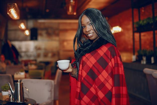 Elegant black girl in a cafe