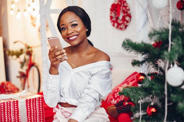 Elegant black girl in the christmas decorations