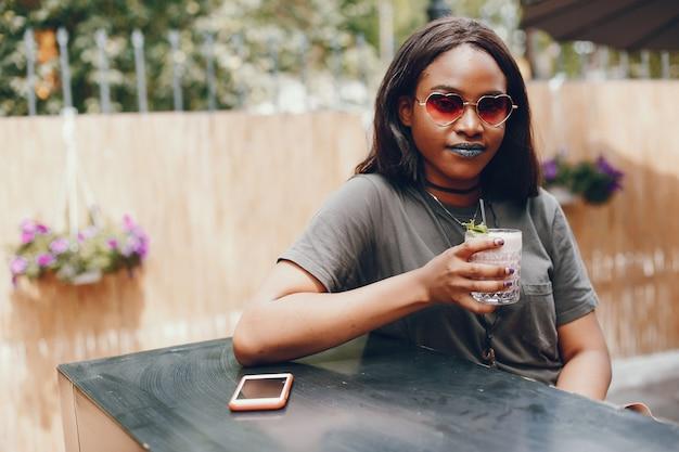 Elegant black girl in a summer city