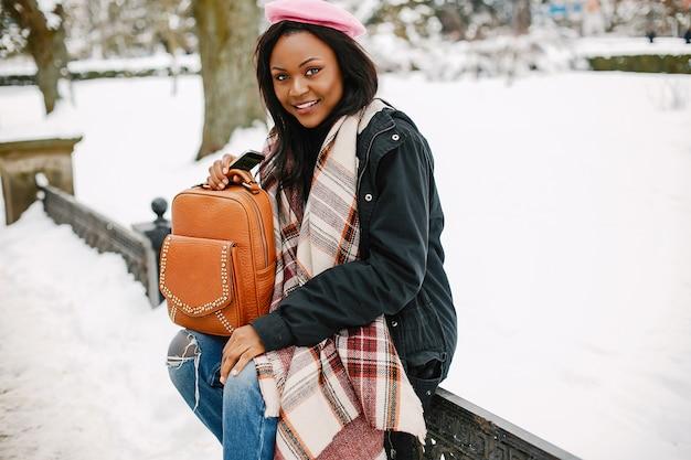 Elegant black girl in a winter city