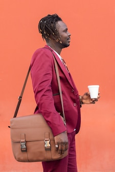 Elegant black man with briefcase and coffee